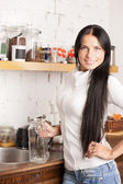 Lovely housewife at the kitchen — Stock Photo