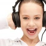 Happy teenage girl in big headphones — Stock Photo #5912571