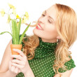 Lovely housewife with flower — Stock Photo #5912625