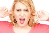 Woman with fingers in ears — Stock Photo