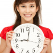 Teenage girl holding big clock — Stock Photo