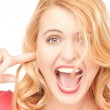 Woman with fingers in ears — Stock Photo #5924907