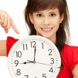 Teenage girl holding big clock - 