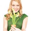 Lovely housewife with flower — Stock Photo #5934227