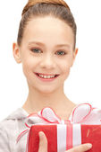 Happy teenage girl with gift box — Stock Photo
