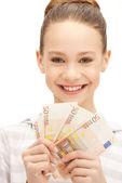 十几岁的女孩用欧元现金钱 — 图库照片