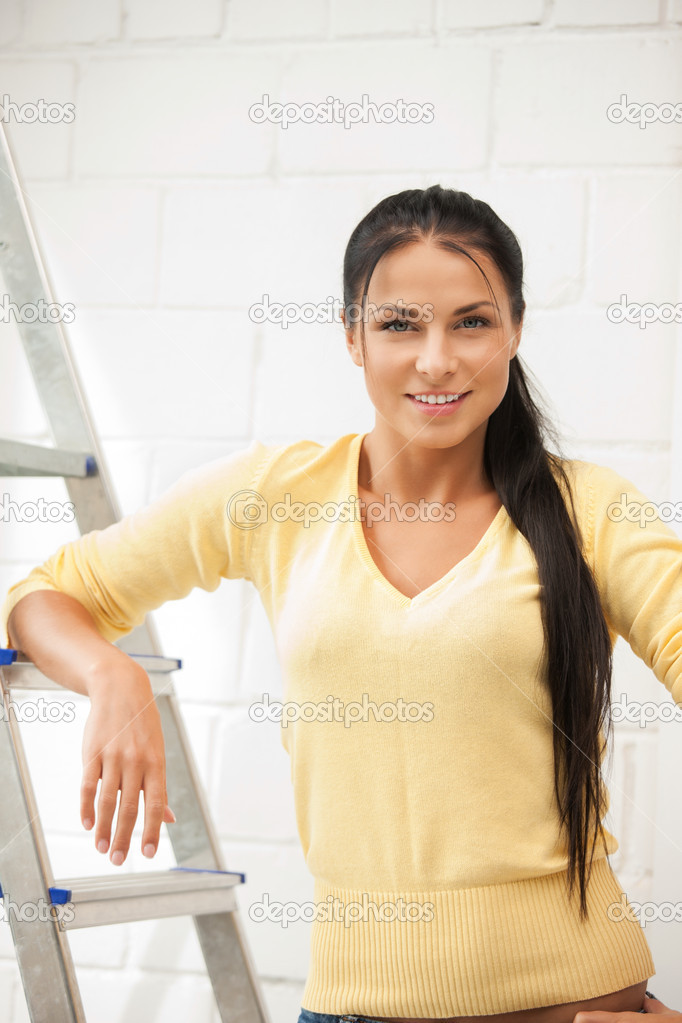 Bright picture of lovely housewife with step ladder — Stock Photo #5934204