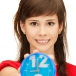 Teenage girl holding alarm clock — Stock Photo #5941753