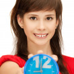 Teenage girl holding alarm clock — Stock Photo #5964481
