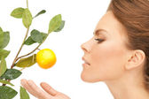 Lovely woman with lemon twig — Stock Photo