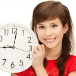 Teenage girl holding big clock — Stock Photo #5974080
