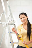 Lovely housewife painting — Stock Photo