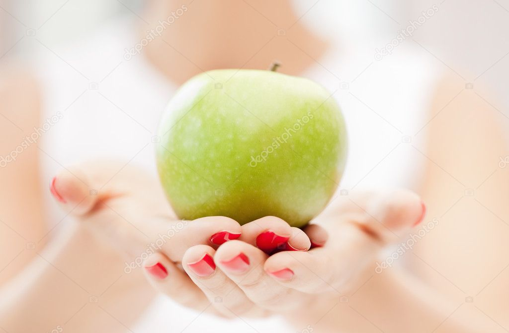 Bright picture of female hands with green apple  Stockfoto #5994162