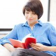 Happy and smiling woman with book — Stock Photo #6006035