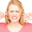 Woman with fingers in ears — Stock Photo #6006062