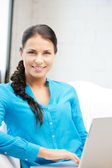Happy woman with laptop computer — Stock Photo