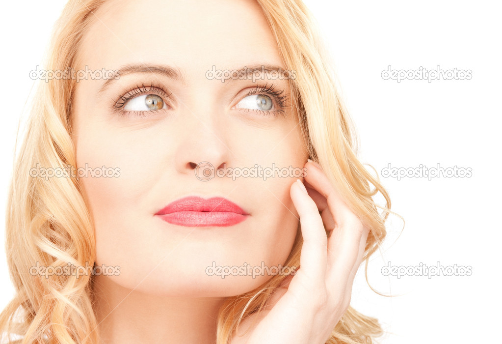 Bright closeup picture of beautiful pensive woman  Stock Photo #6006066