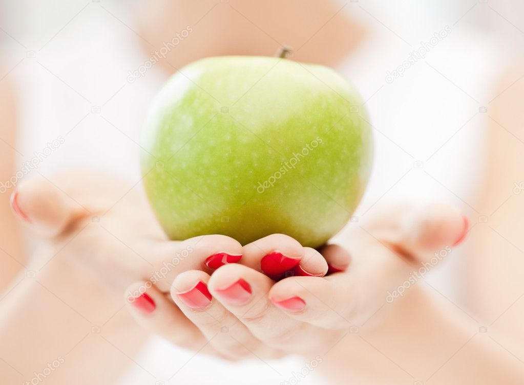 Bright picture of female hands with green apple — Stock Photo #6019685