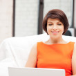 Happy woman with laptop computer — Stock Photo #6032711