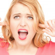 Woman with fingers in ears — Stock Photo #6052332