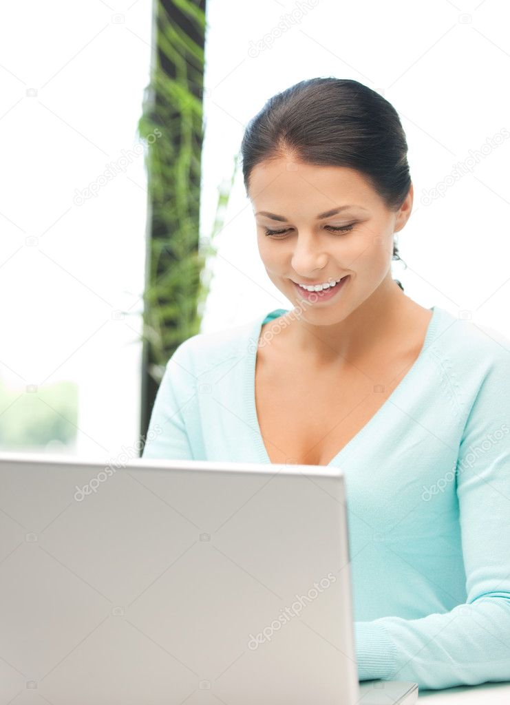 Picture of happy woman with laptop computer  Stock Photo #6052259