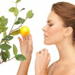 Lovely woman with lemon twig — Stock Photo #6066988
