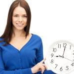 Woman holding big clock — Stock Photo #6067055