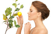 Lovely woman with lemon twig — Stockfoto