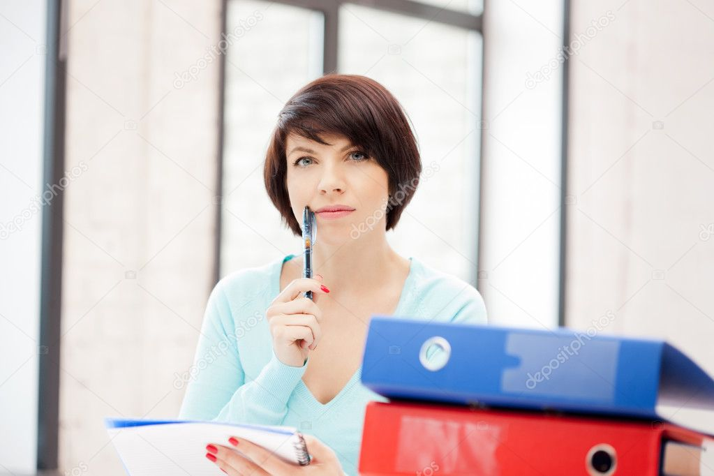 Bright picture of beautiful woman with folders — Stock Photo #6109993