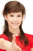 Teenage girl with an open hand ready for handshake — Stock Photo