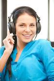Happy teenage girl in big headphones — Stock Photo