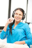 Happy teenage girl in big headphones — Zdjęcie stockowe