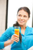 Beautiful woman with glass of juice — Stock Photo