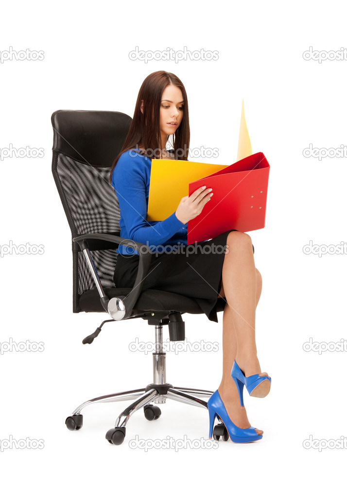 Picture of young businesswoman with folders sitting in chair — Stock Photo #6220889
