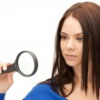 Woman with magnifying glass — Stock Photo #6248193