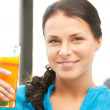 Beautiful woman with glass of juice — Stock Photo #6258435