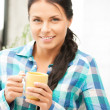 Lovely housewife with mug — Stock Photo #6258484