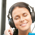 Happy teenage girl in big headphones — Stock Photo #6270910