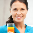 Beautiful woman with glass of juice — Stock Photo #6275896