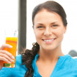 Beautiful woman with glass of juice — Stock Photo #6287523