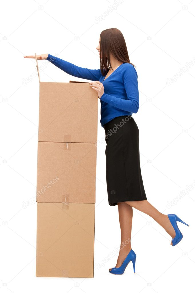 Picture of attractive businesswoman with big boxes  Stock Photo #6426907