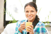 Lovely housewife with mug — Stok fotoğraf