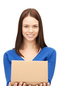 Attractive businesswoman with cardboard box — Stock Photo