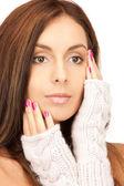 Beautiful woman in mittens — Foto de Stock