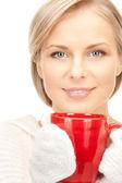 Woman with red mug — Stock Photo