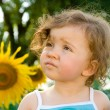 Baby with sunflower — Stock Photo #5758983