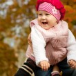 Стоковое фото: Laughing girl in mother's hands