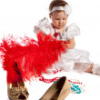 Little girl holding big red feather, isolated — Stockfoto