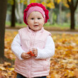 Girl in autumn leaves — Stock Photo