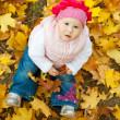Girl in yellow leaves — Stock Photo